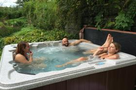 Stay Home and Soak in The Garden Hot Tub